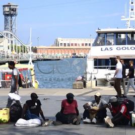 Imigrantes na marina de Barcelona